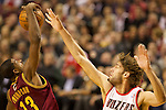 01/15/13-- Cleveland Cavaliers power forward Tristan Thompson (13) goes for a rebound against Portland Trail Blazers center Robin Lopez (42) in the first half at Moda Center.<br />