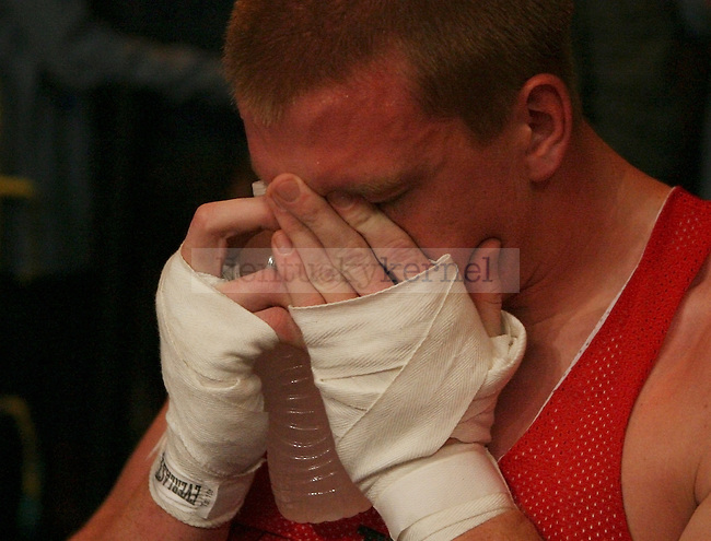 Delta Tau Delta Reese Ward reacts after hurting his leg while boxing at The Main Event at the Lexington Convention Center in Lexington, Ky., on Thursday, November 7, 2013. Photo by Tessa Lighty | Staff