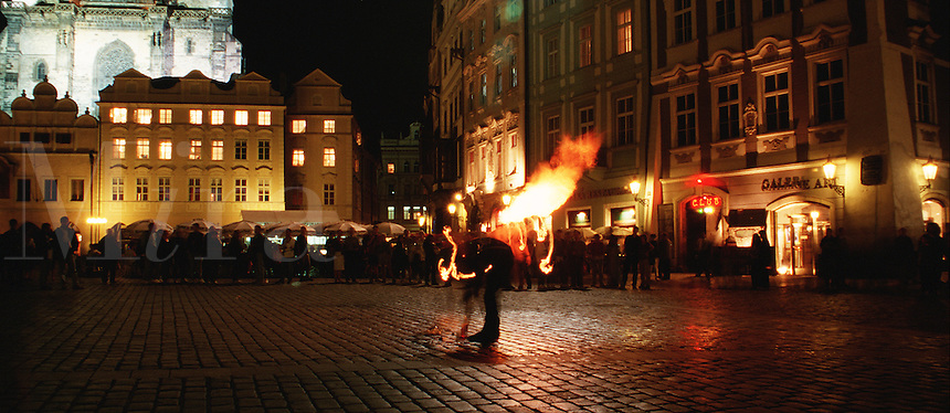An entertainer in Prague's Old Town Square at night. Prague, Czech Republic.