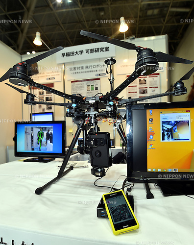 October 15, 2014, Tokyo, Japan - A disaster response flyer is shown at Japan Robot Seek 2014, an exhibition of service robots and related technologies, at Tokyo Big Sight on Thursday, October 15, 2014. The unmanned flying robot transmits what it sees to the operator's cellphone. The three-day exhibition showcases the cutting-edge technologies and components of service and disaster response robots.  (Photo by Natsuki Sakai/AFLO)