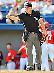 10 March 2012: MLB umpire Jeff Nelson makes a gesture during a Spring Training game between the New York Mets and the Washington Nationals at Space Coast Stadium in Viera, Florida. The Nationals defeated the Mets 8-2 in Grapefruit League play. Mandatory Credit: Ed Wolfstein Photo
