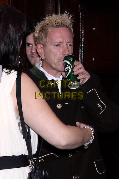 JOHN LYDON (Johnny Rotten).The Glenfiddich MOJO Honours List award ceremony, the Brewery, Chiswell St., London, England..July 21st, 2011.half length black jacket carlsberg beer can alcohol drink beverage.CAP/COA/CC.©CC/COA/Capital .