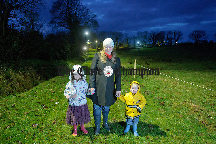 Mona Garry with her daughter Roisin and son Micheal walking on the new floodlight West Clare Sports And Fitness Club facility in Clonreddan. Photograph by John Kelly.