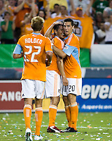 Houston Dynamo midfielder Stuart Holden (22) and Houston Dynamo midfielder Geoff Cameron (20) celebrate a goal by Houston Dynamo forward Brian Ching (25).  Houston Dynamo defeated D.C. United 4-3 at Robertson Stadium in Houston, TX on August 1, 2009.