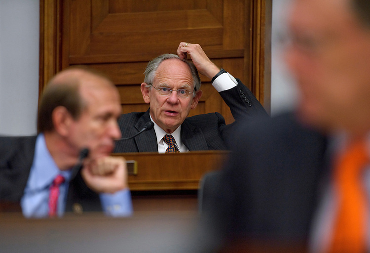 WASHINGTON, DC - Sept. 22: Rep. Michael N. Castle, R-Del., questions Treasury Secretary Timothy F. Geithner during the House Financial Services hearing on the status of the international financial system and the implementation of the Dodd-Frank Act. At left is Rep. Scott Garrett, R-N.J.; at right is Rep. Bill Posey, R-Fla. (Photo by Scott J. Ferrell/Congressional Quarterly)