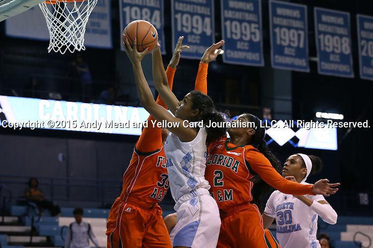17 November 2015: North Carolina's Erika Johnson (center) is defended by Florida A&M's Mariah Reynolds (33) and Dawn King (2). The University of North Carolina Tar Heels hosted the Florida A&M University Rattlers at Carmichael Arena in Chapel Hill, North Carolina in a 2015-16 NCAA Division I Women's Basketball game. UNC won the game 94-58.