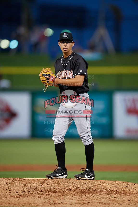 Jupiter Hammerheads starting pitcher Robert Dugger (12) gets ready to deliver a pitch during a game against the Clearwater Threshers on April 12, 2018 at Spectrum Field in Clearwater, Florida.  Jupiter defeated Clearwater 8-4.  (Mike Janes/Four Seam Images)