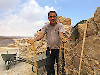 15. &quot;Workman repairs walls of Masada&quot;: Judean Desert.<br />