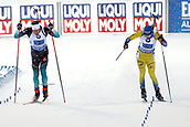 16th March 2019, Ostersund, Sweden; IBU World Championships Biathlon, day 8, mens relay; Martin Fourcade (FRA) and Sebastian Samuelsson (SWE) who sprints with a broken pole at the finish straight