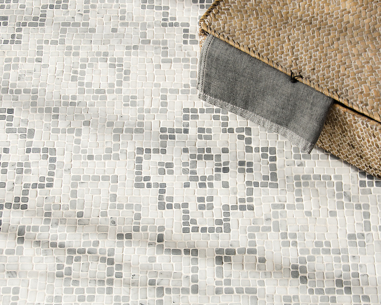 Bahir, a hand-chopped stone mosaic, shown in tumbled Carrara, light Bardiglio, and medium Bardiglio, is part of the Legend® Collection by New Ravenna.