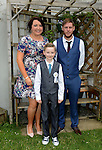 16/05/2015 - Mell Communion – Joseph Kelly and his parents Sarah Matthews and Chris Kelly. Picture: www.newsfile.ie