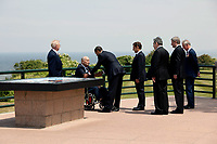 President Barack Obama speaks with veteran Ben Franklin at Normandy along with veteran Clyde Combs (left), French President Nicolas Sarkozy, British Prime Minister Gordon Brown, Canadian Prime Minister Stephen Harper and England's Prince Charles during the 65th anniversary of the D-Day invasion on June 6, 2009.  (Official White House photo by Pete Souza)<br /> <br /> This official White House photograph is being made available for publication by news organizations and/or for personal use printing by the subject(s) of the photograph. The photograph may not be manipulated in any way or used in materials, advertisements, products, or promotions that in any way suggest approval or endorsement of the President, the First Family, or the White House.