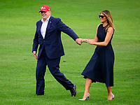 United States President Donald J. Trump and first lady Melania Trump wave to guests as they return to the South Lawn of the White House in Washington, DC from their European trip on Friday, June 7, 2019.<br /> CAP/MPI/RS<br /> ©RS/MPI/Capital Pictures