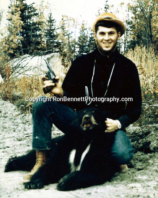 Ron Bennett photographer and the black bear he shot in Alaska.