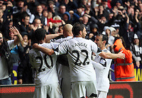 Sunday, 26 April 2014<br /> Pictured: Wilfried  Bony mobbed by team mates as he is celebrating his goal.<br /> Re: Barclay's Premier League, Swansea City FC v Aston Villa at the Liberty Stadium, south Wales.