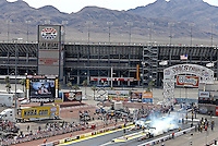 Apr. 7, 2013; Las Vegas, NV, USA: NHRA top fuel dragster driver Steve Faria (near lane) does his burnout alongside Clay Millican during the Summitracing.com Nationals at the Strip at Las Vegas Motor Speedway. Mandatory Credit: Mark J. Rebilas-