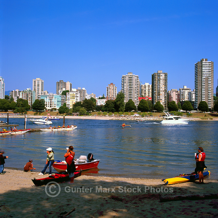 Vancouver, BC, British Columbia, Canada - Recreational Sea Kayaking and Boating in English Bay at False Creek, West End of Vancouver Skyline and Sunset Beach in background