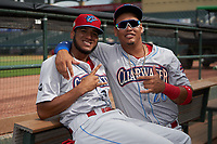 Clearwater Threshers Daniel Brito (21) and Jhailyn Ortiz (26) pose for a photo before a Florida State League game against the Palm Beach Cardinals on August 10, 2019 at Roger Dean Chevrolet Stadium in Jupiter, Florida.  Clearwater defeated Palm Beach 11-4.  (Mike Janes/Four Seam Images)