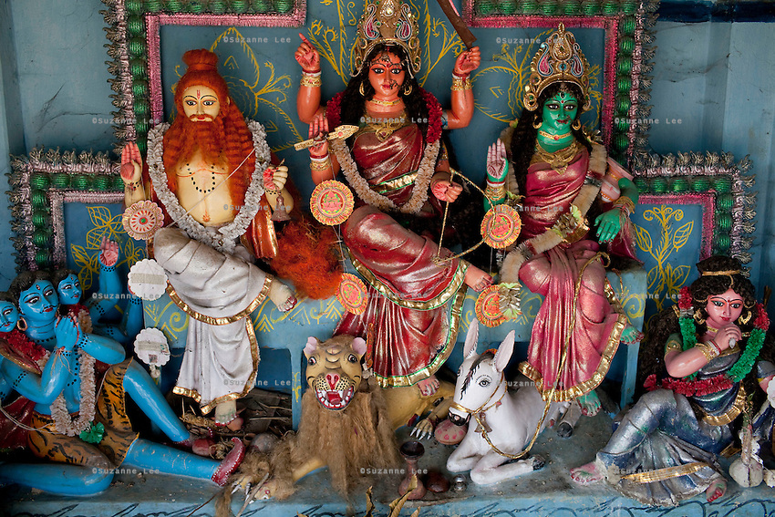 An idol of the goddess Durga, who is always depicted riding a tiger, in the Bono Debi/Bono Bibi temple on Gosaba island, Sundarban, West Bengal, India, on 18th January, 2012. A tiger hid in this temple after attacking a woman. Villagers pray to this endemic goddess, known as Bono Debi to Hindus and Bono Bibi to Muslims, to protect them from tigers. Tigers have been known to swim, sometimes underwater, to the village to hunt humans. A successful Royal Bengal tiger breeding program has increased their numbers but decreased the number of husbands. There are now an estimated 3,000 widows in the villages where their husbands, have been killed by tigers. Photo by Suzanne Lee for The National (online byline: Photo by Szu for The National)