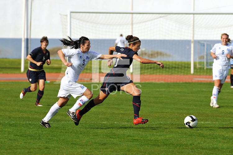 Carli Lloyd pulls away from an Icelandic defender. The USWNT defeated Iceland (2-0) at Vila Real Sto. Antonio in their opener of the 2010 Algarve Cup on February 24, 2010.