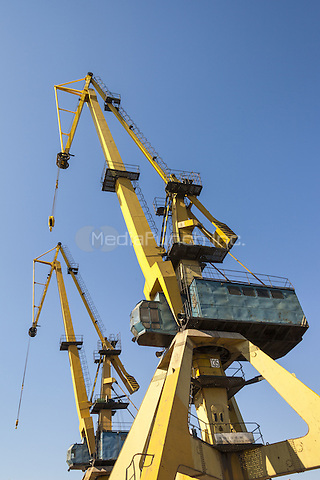 Yellow cargo cranes at the docks in the port of Constanta, Romania   June 2015<br /> CAP/MEL<br /> &copy;MEL/Capital Pictures /MediaPunch ***NORTH AND SOUTH AMERICA ONLY***