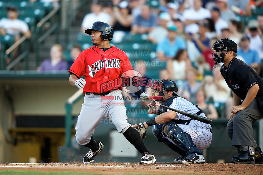 Indianapolis Indians outfielder Jose Tabata #18 bats in front of catcher Francisco Cervelli and umpire Jeff Gosney during a game against the Empire State Yankees at Frontier Field on August 4, 2012 in Rochester, New York.  Empire State defeated Indianapolis 9-8 in ten innings.  (Mike Janes/Four Seam Images)