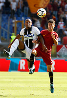 Calcio, Serie A: Roma vs Udinese. Roma, stadio Olimpico, 23 settembre 2017.<br /> Udinese&rsquo;s Samir, left, and Roma&rsquo;s Diego Perotti jump for the ball during the Italian Serie A football match between Roma and Udinese at Rome's Olympic stadium, 23 September 2017. Roma won 3-1.<br /> UPDATE IMAGES PRESS/Riccardo De Luca