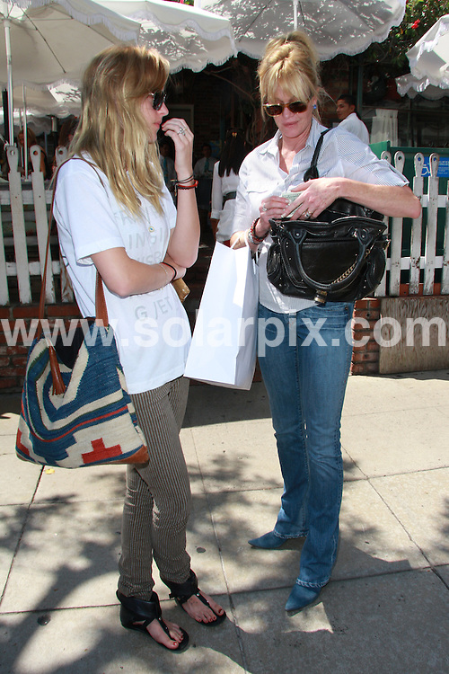 **ALL ROUND PICTURES FROM SOLARPIX.COM**.**WORLDWIDE SYNDICATION RIGHTS**.**NO PUBLICATION IN AUSTRALIA, DENMARK, GERMANY, NEW ZEALAND, OR USA**.Melanie Griffith and daugter spend the day shopping on Robertson blvd. in Beverly Hills. USA.JOB REF:  7187      LAP / JS      DATE: 03.09.08.**MUST CREDIT SOLARPIX.COM OR DOUBLE FEE WILL BE CHARGED* *UNDER NO CIRCUMSTANCES IS THIS IMAGE TO BE REPRODUCED FOR ANY ONLINE EDITION WITHOUT PRIOR PERMISSION*