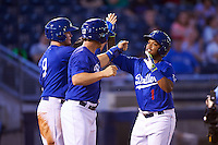 Tulsa Drillers second baseman Willie Calhoun (1) is congratulated at home by Alex Verdugo (9) and Kyle Farmer (17) after hitting a home run during a game against the Arkansas Travelers on April 25, 2016 at ONEOK Field in Tulsa, Oklahoma.  Tulsa defeated Arkansas 4-3.  (Mike Janes/Four Seam Images)