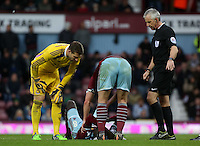 Sunday 07 December 2014<br /> Pictured: Adrian of West Ham (L) and match referee Chris Hoy (R) see to Cheikhou Kouyate of West Ham who is injured on the ground<br /> Re: Premier League West Ham United v Swansea City FC at Boleyn Ground, London, UK.
