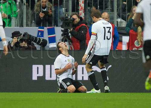 29.03.2016. Munich, Germany. International soccer match between Germany and Italy, at the Allianz Arena in Munich.  Mario Gotze Germany and Thomas Mueller Germany celebrate their goal