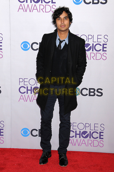 Kunal Nayyar.People's Choice Awards 2013 - Arrivals held at Nokia Theatre L.A. Live, Los Angeles, California, USA..January 9th, 2013.full length black trousers suit coat blue trousers hands in pockets .CAP/ADM/BP.©Byron Purvis/AdMedia/Capital Pictures.