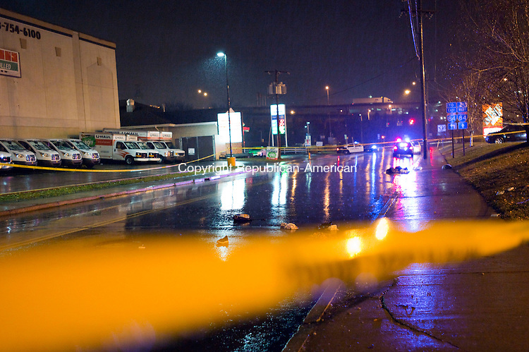 Waterbury, CT- 23 December 2015-122315CM12- Items are strewn across the road,  as Waterbury police investigate the scene of a fatal accident on Bank Street on Wednesday evening.  Police say Theresa Coll, of Waterbury was killed as she was crossing Bank Street at around 4:50 p.m. on Wednesday.  Christopher Massa Republican-American