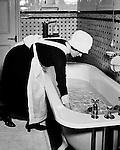 Parlourmaid prepares bath, 1939