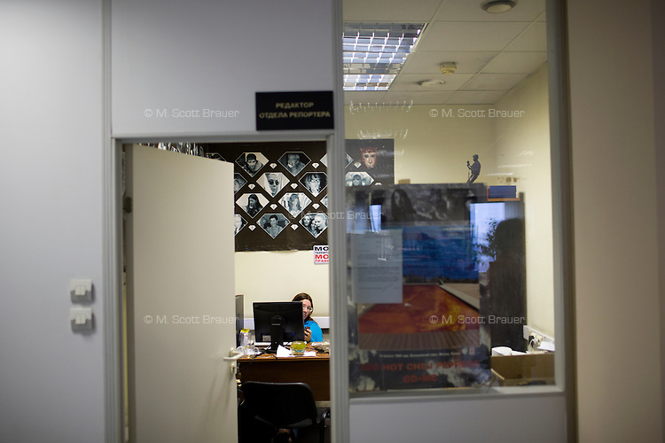 A Moskovskii Komsomolets news editor works in her office in the newspaper's offices in Moscow, Russia.