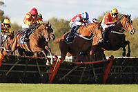 Well Mett ridden by Timmy Murphy (L), Dancing Dude ridden by Andrew Tinkler (C) and Call At Midnight ridden by Mark Marris jump during the Ingrebourne Valley Handicap Hurdle