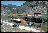 RGS #74 with southbound RMRRC excursion stopped at Brown for water, lunch and exploring.  Consist is cabooses #0400 and #0401, three gondolas and business car B-20 &quot;Edna&quot;.<br /> RGS  Brown, CO  Taken by Kindig, Richard H. - 9/1/1951