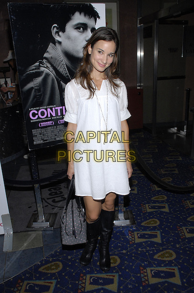 "ALISON BECKER.New York premiere of The Weinstein Company's ""Control"" held at Chelsea West Cinema, New York City, New York, USA..September 25th, 2007.full length white dress silver gun pistol necklace grey gray pink pattern bag purse black boots .CAP/ADM/BL.©Bill Lyons/AdMedia/Capital Pictures. *** Local Caption ***"