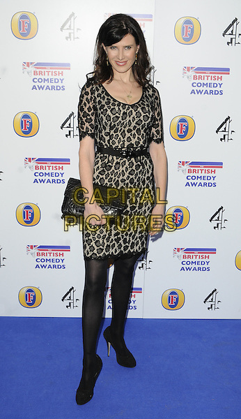 RONNI ANCONA .Attending the British Comedy Awards 2011at Indigo, The O2 Arena, London.England, UK, January 22nd, 2011..arrivals full length black beige print dress clutch bag shoes tights lace animal .CAP/CAN.©Can Nguyen/Capital Pictures.