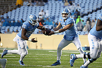 CHAPEL HILL, NC - NOVEMBER 23: Sam Howell #7 of the University of North Carolina hands the ball off to Javonte Williams #25 during a game between Mercer University and University of North Carolina at Kenan Memorial Stadium on November 23, 2019 in Chapel Hill, North Carolina.