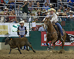 Action from the Tie-Down Roping event during the Reno Rodeo in Reno, Nevada on Saturday, June 23, 2018.