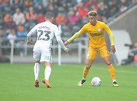Preston North End's Callum Robinson under pressure from Swansea City's Connor Roberts<br /> <br /> Photographer Kevin Barnes/CameraSport<br /> <br /> The EFL Sky Bet Championship - Swansea City v Preston North End - Saturday August 11th 2018 - Liberty Stadium - Swansea<br /> <br /> World Copyright &copy; 2018 CameraSport. All rights reserved. 43 Linden Ave. Countesthorpe. Leicester. England. LE8 5PG - Tel: +44 (0) 116 277 4147 - admin@camerasport.com - www.camerasport.com