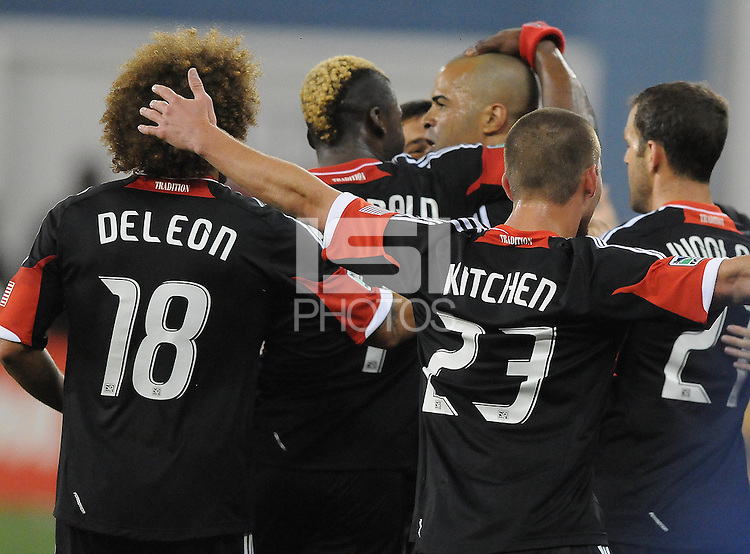 D.C. United forward Maicon Santos (29) celebrates his score in the 72th minute of the game with teammates. D.C. United tied The Montreal Impact 1-1, at RFK Stadium, Wednesday April 18 , 2012.