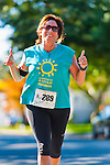 Oct. 21, 2012 - Merrick, New York, U.S. - Runner makes thumbs up sign after passing the 3 mile mark of the 5th Annual Blazing Trails for Autism 4 Mile Run for charity. All net proceeds are dedicated to the non-profit Eden II and Genesis Foundation, which supports children and adults with autism. The Greater Long Island Running Club adminsters the run, which travels through North Bellmore and North Merrick, and the Run is sanctioned, and Course is certified, by USA Track & Field.
