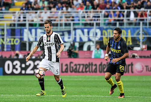 18.09.2016. San Siro Stadium, Milan, Italy. Miralem Pjanic of Juventus breaks from Eder during Italian Serie A League Football. Inter versus Juventus.