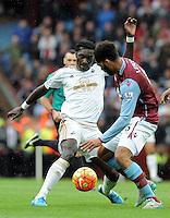 Bafetimbi Gomis of Swansea City and Joleon Lescott of Aston Villa during the Barclays Premier League match between Aston Villa v Swansea City played at the Villa Park Stadium, Birmingham on October 24th 2015