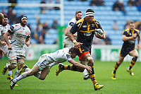Nathan Hughes of Wasps is tackled by Will Chudley of Exeter Chiefs. European Rugby Champions Cup quarter final, between Wasps and Exeter Chiefs on April 9, 2016 at the Ricoh Arena in Coventry, England. Photo by: Patrick Khachfe / JMP