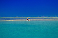 Three woman waving from Ahu o laka  sandbar, on gorgeous Kaneohe Bay, Island of Oahu, Hawaii