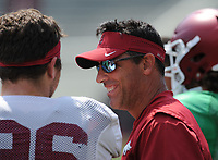 NWA Democrat-Gazette/ANDY SHUPE<br /> Arkansas offensive coordinator Dan Enos speaks Saturday, Aug. 5, 2017, with linebacker Karl Roesler prior to the start of a scrimmage in Razorback Stadium in Fayetteville. Visit nwadg.com/photos to see more photographs from the practice.