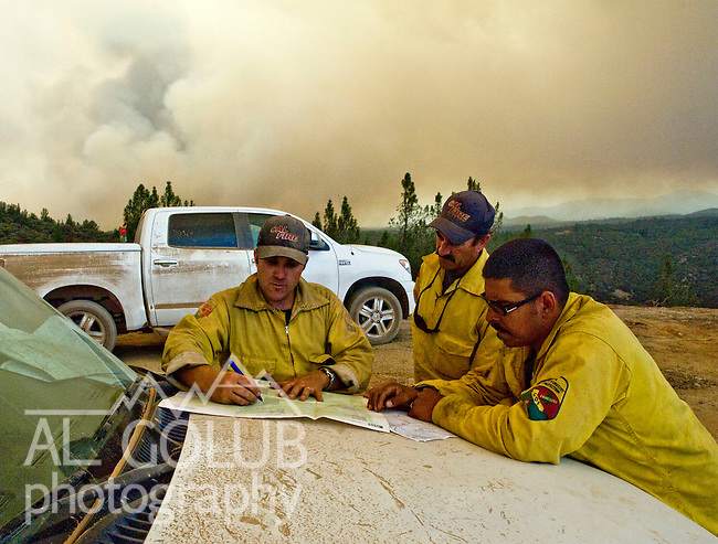 Greeley Hill, California-- July 29, 2008-Telegraph Fire-Wildfires Threaten Yosemite National Park .CalFire Division Planers make plans for Division N while  Division M of Branch Three bumps over the line.  Fire blows up near Halls Gulch and  Bull Creek Road. This fire is out of control and will have to be caught on the next fire break. ..Photo by Al Golub/Golub Photography.